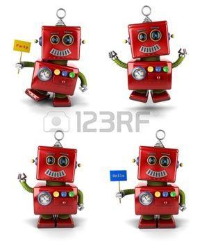 Poco robot juguete de la vendimia fijado saltando y agitando sobre fondo blanco photo