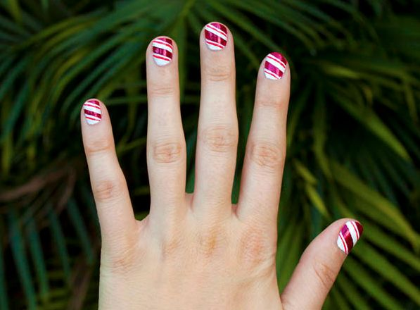 Getting a holiday-ready manicure is easy — all you need is a little tape and a skinny paint brush! Play around with various colors if you'd like to turn this candy cane mani into more of a ribbon candy look. Get the tutorial at SheKnows »  - GoodHousekeeping.com