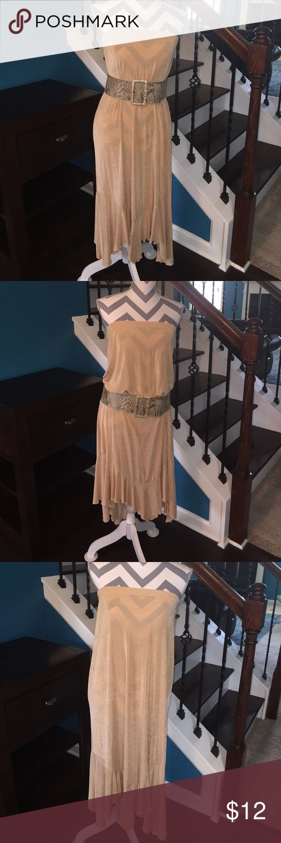 Bouncy Tan Maxi Skirt Versatile maxi skirt. Wear as a dress with a slip or as a fun cover up at the beach. Super stretchy waist. Sheer material. Fun ruffled hem. Skirts Maxi