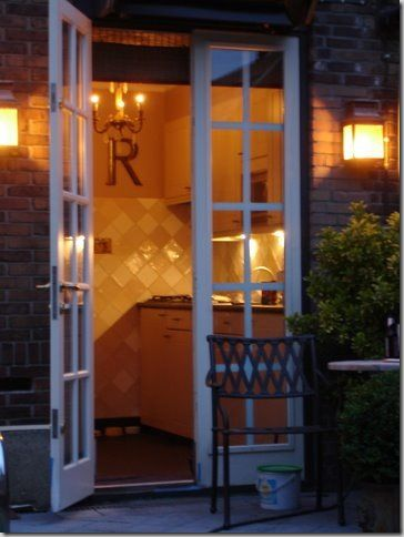 doors kitchen to  outside.   Narrow French doors to open from studio onto garden