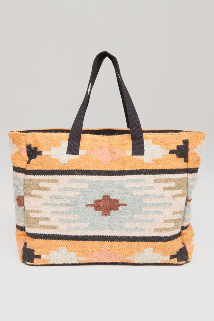The Permanent Vacation Tote is a textured denim woven bag with lining and zip closure.