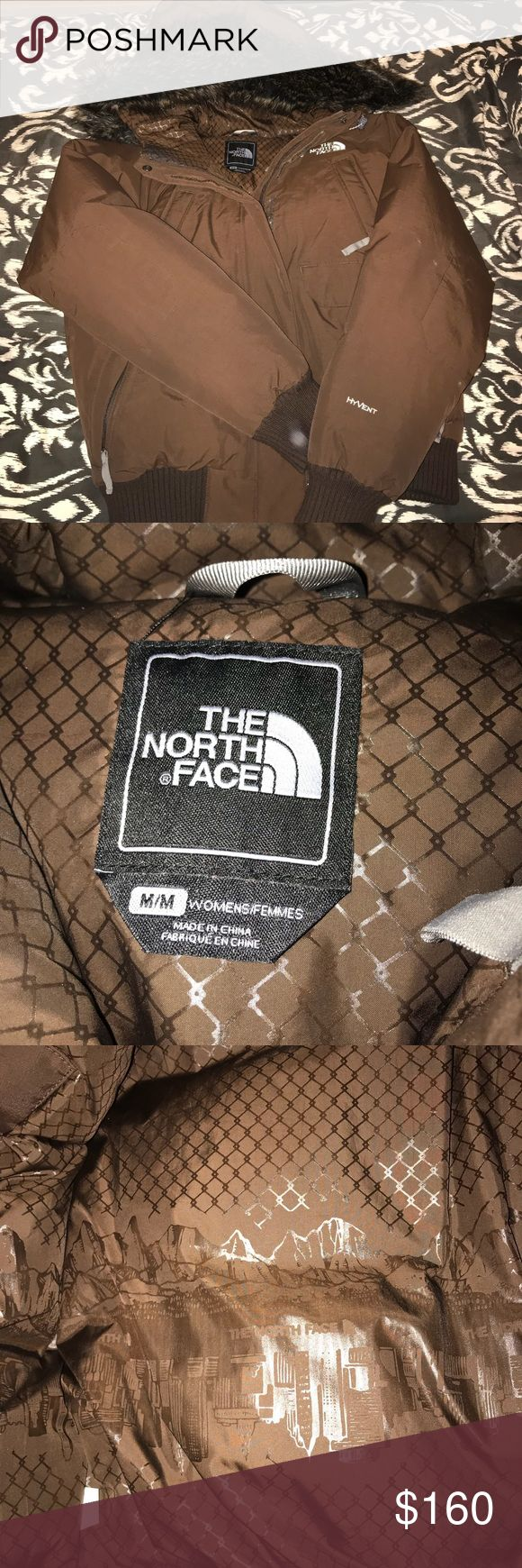 North Face Jacket The North Face puffer jacket in a dark brown .. extremely warm and in great condition (just fits me too small) .. small black mark on back/shoulder on one side (as shown in last picture) .. open to offers, no trades The North Face Jackets & Coats Puffers