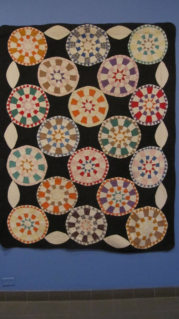 An antique quilt (Folk Art Museum, New York). Found in Sue Spargo's blog.
