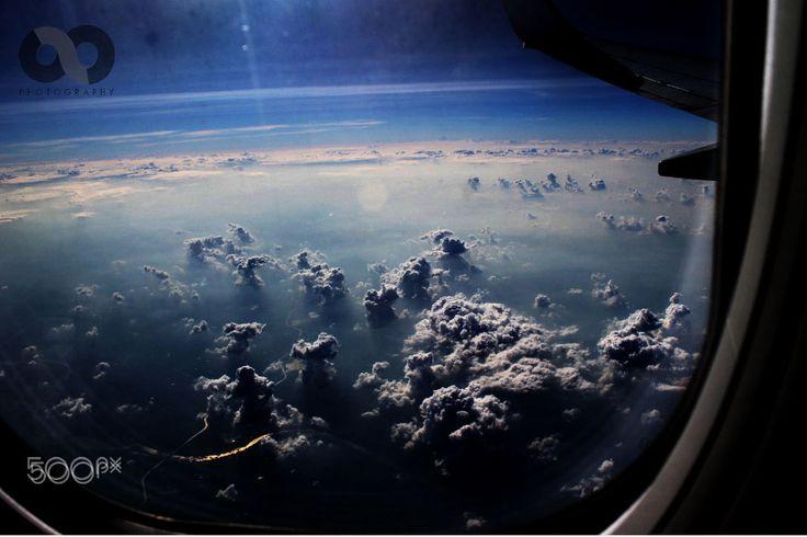 Clouds through lens - Cloud through plane glass and camera lens..