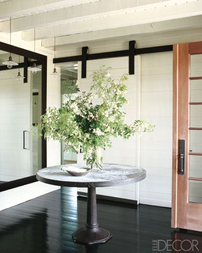 foyer in meg ryan's martha's vineyard home  Like the idea of sliding doors to provide privacy instead of all open.