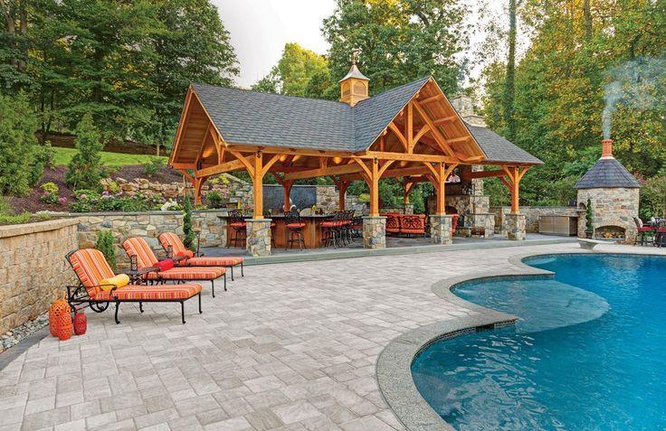 Bristol Stone paver patio leads to a beautiful poolside pavilion. www.ephenry.com