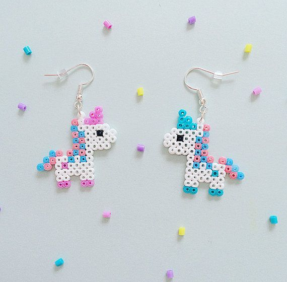 A pair of super-cute bubblegum pixel unicorn earrings, available in four kawaii pastel colours:- ♥ Pastel Pink ♥ Pastel Blue ♥ Pastel Yellow ♥ Pastel Purple Please leave a message in the Note To Seller section at the checkout with your colour choices! You can choose a matching pair or two different colours. If no note is left, I will send you a matching pair in a randomly selected colour. Cant decide which ones you like best? Why not treat yourself to the full set of four and mix & mat...