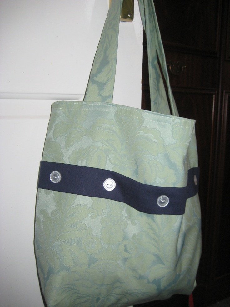 Handmade  Satinised/Embossed Cotton Tote Bag With Button Detail. £9.50, via Etsy.
