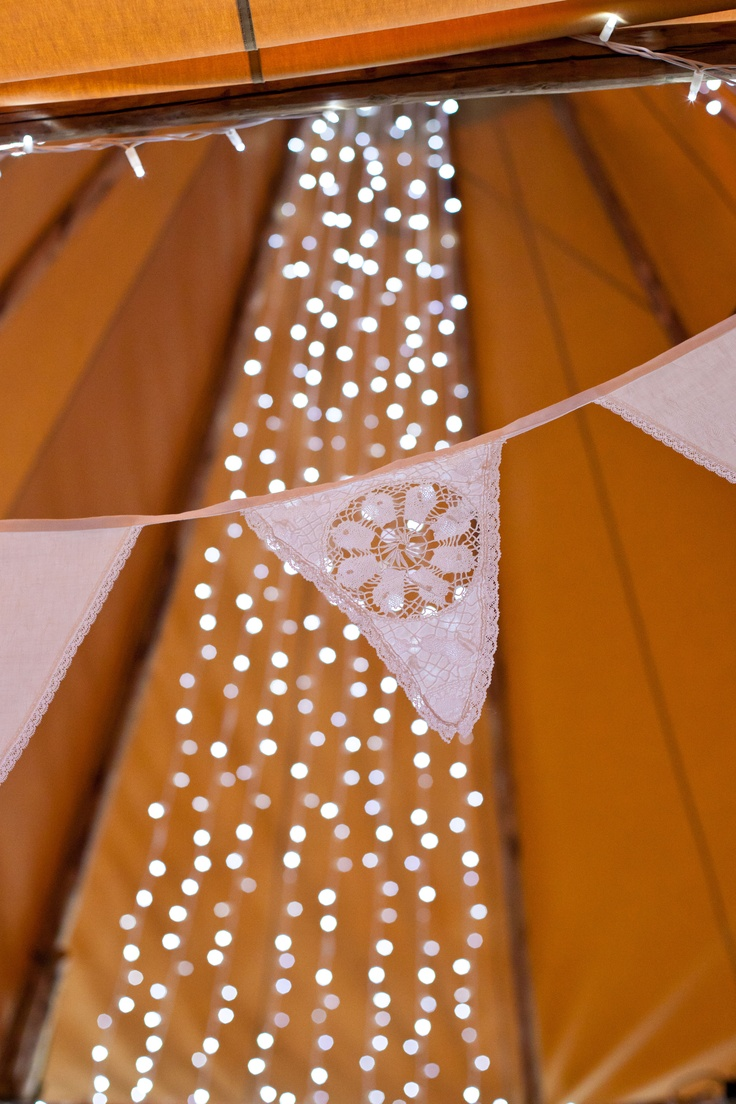 Bunting and fairy light drapes - styling by http://www.jollygoodwedding.com/