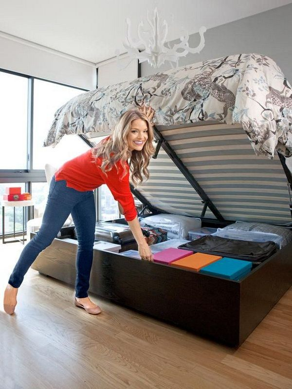 Secret Storage Under Hydraulic Bed. Use a hydraulic system to lift up the mattress easily to reveal additional storage space for your home. Keep plastic bins, suitcases and out of season stuff organized and out of sight. http://hative.com/creative-under-bed-storage-ideas-for-bedroom/