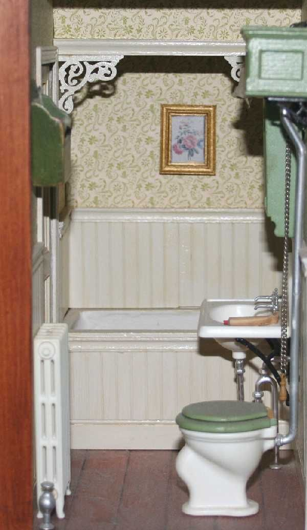 I like the way to enclose the tub with the apron at the top and the brackets add a nice touch miniature bathroom