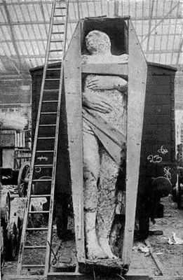"""Irish Giant  This photo of a 'fossilized Irish giant' was taken at a London rail depot & appeared in the 12/1895 issue of Strand Mag. The giant was found by a Mr Dyer while looking for iron ore in County Antrim. It was 12' 2"""" (3.71 m) tall, weighed 2 tonnes & had 6 toes on its right foot. After a showing inDublin, it came to  liverpool & Manchester England, attracting all kinds. After a legal dispute over ownership, nothing more appears to have been heard or seen of the exhibit."""