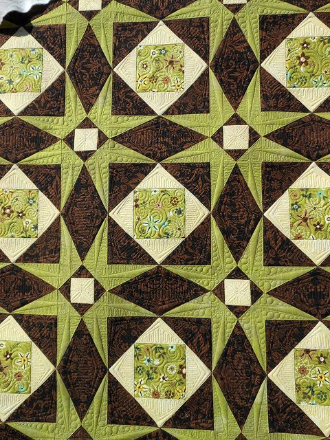 Judi Madsen at Green Fairy Quilts. Her free longarm quilting is incredible.