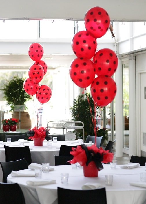 Decorate red balloons with black spots to resemble lady bugs. - a movie night decorating idea for showing a bug themed movie from Southern Outdoor Cinema