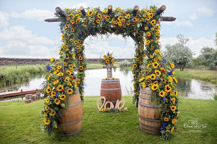 Custom made wooden arch by groom's parents, old wooden wine barrel, sunflowers, private pond, and love in the air. S+C wedding: 07/01/2016