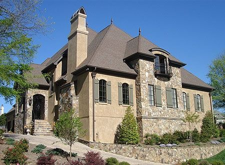 French stone and stucco homes french stone and stucco for Stucco homes with stone accents