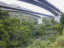 Drive on the Interstate H-3. (Oahu) It goes through the beautiful Halawa Valley and has a long tunnel to get from one side of the island to the other.  Another former job site of my husband's, it cost $80 million to build his 1-mile stretch of the viaduct.