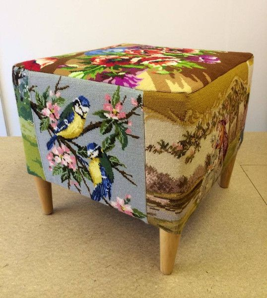 Cube footstool reupholstered in an eclectic variety of needlepoint tapestries.