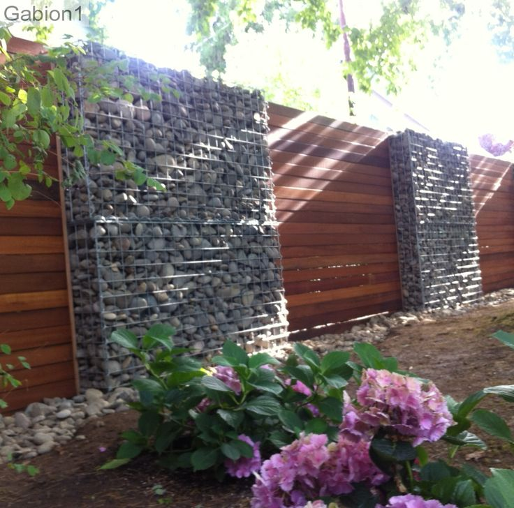 timber and gabion fence in Portland Oregon, using 2 rows of 5' wide x 3'tall gabions to build each 6' tall gabion segment http://www.gabion1.com