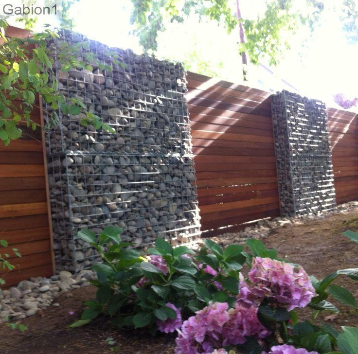 timber and gabion fence in Portland Oregon, using 2 rows of 5' wide x 3'tall gabions to build each 6' tall gabion segment http://www.gabion1.com