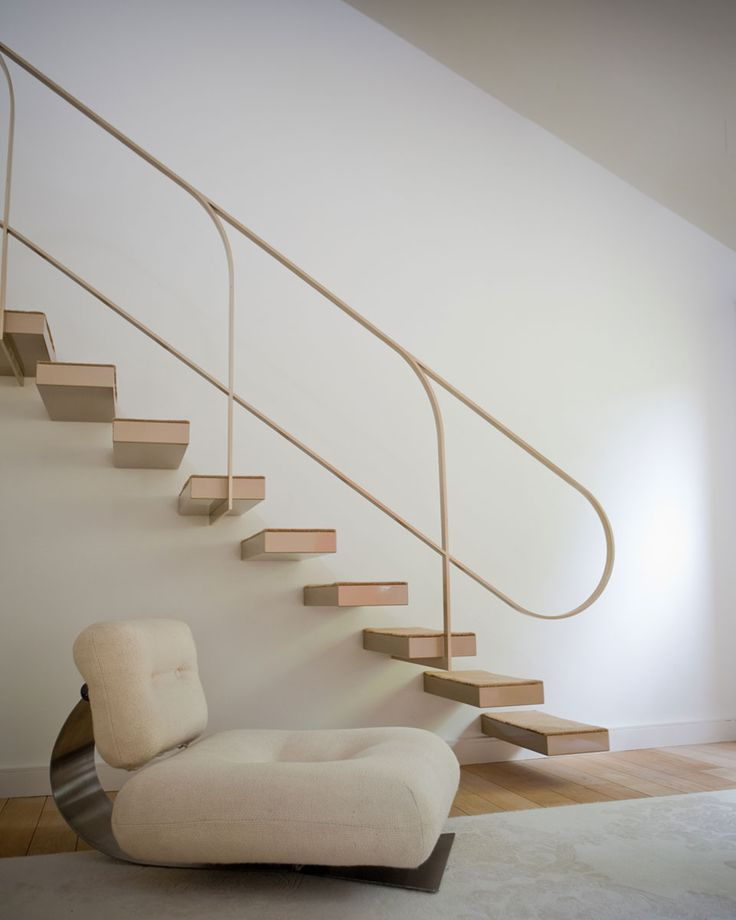 metal railing & floating steps, echo curves of vintage furniture, Cadeira Lounge - Oscar Niemeyer (1972)   © Buttazzoni & associés