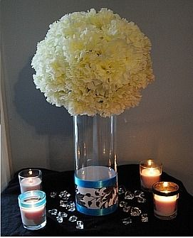 That pomander ball on a square vase for the bottom.  LOVE it. :) then with the table numbers on the inside of the square vase... ummm my vision is start to be born.  :)