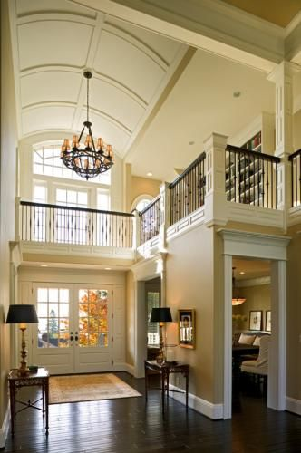Grand entry... love the two floor layout, and the bookshelves upstairs