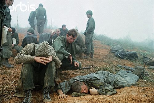Apr 1968, Near Khe Sanh, South Vietnam --- 4/4/1968-Near Khe Sanh, South Vietnam-First Cavalry men, many with head wounds, wait to be evacuated from a hilltop along route #9, during their advance toward Khe Sanh. --- Image by © Bettmann/CORBIS