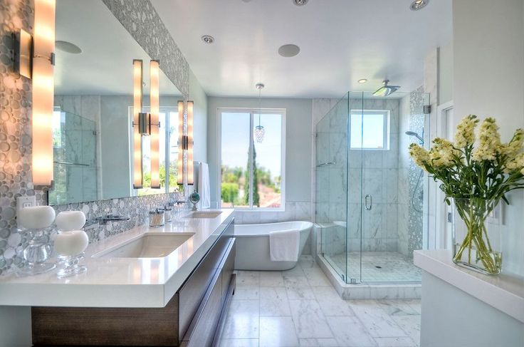 Contemporary Master bathroom clean light and bright bath with white marble and glass tile for a young on the go couple. Downtown address with great style. #marbletiles #sefastoneusa #interiordesign #decorideas #home #bathroom