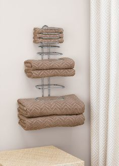 Display your towels and save space in your linen closet when you have this Folded Towel Rack