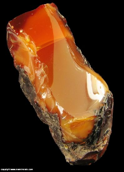 Mineral Specimen #1472 - Cherry Opal - Jalisco, Mexico - A very large piece of Cherry Opal which formed in a seam. The color is a very attractive bright orange. The luster is so high, especially on one side. In fact, I at first thought it was polished on that side. Please note, there is no fire present in the specimen. - From the Vivian Randall collection - 5.7 x 4.7 x 2.4 cm - 87 g