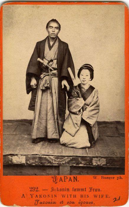 A yakonin with his wife holding a katana, Yokohama, ca. 1869-1870 by Wilhelm J. Burger