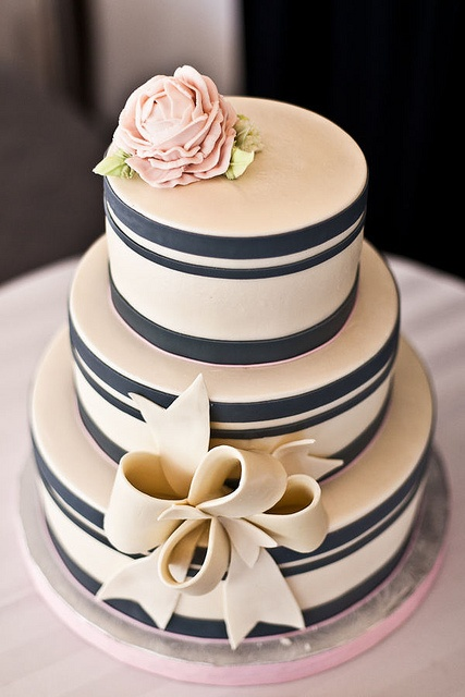Classic striped cake with bow - change to gold instead of blue. So pretty!