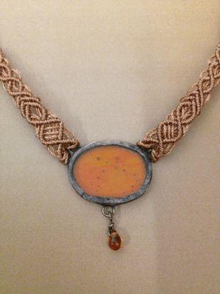 Copper colored-orange macrame glass necklace, small oval
