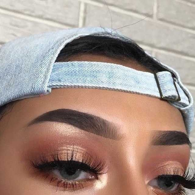 Groomed brows and glam eye make-up smokey eyes, bold lipstick, and nail art. Beautiful, natural makeup, makeup ideas, beauty, skincare, skincare tips, best acne treatments, beauty products, smoky eye, lipstick, glamorous make-up, natural make-up.
