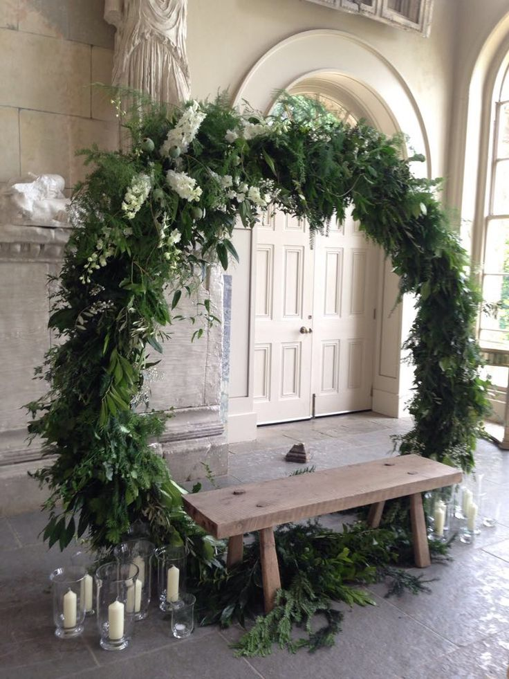 Boho Floral Wedding Arch. This is our latest lovely idea for the top of the aisle, a hoop of wild flowing foliage and asymmetric white delphiniums at Aynhoe Park