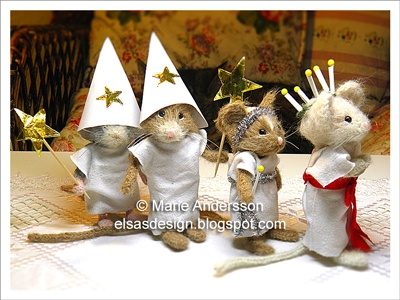 St. Lucia's Day-- I love this :)  Dress up some wee toys you already have for a St. Lucy parade!
