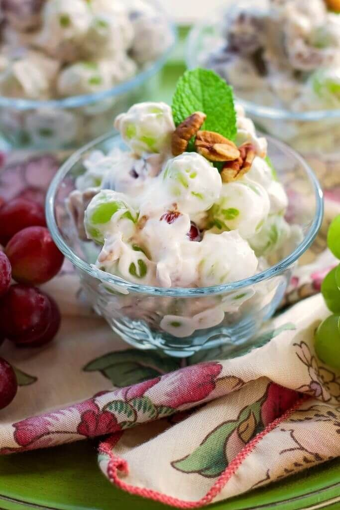 Creamy Delicious Grape Salad Made With Grapes Pecans Sour Cream And Cream Cheese This Summer Fruit Salad Is Cool Creamy Grape Salad Fruit Recipes Delicious