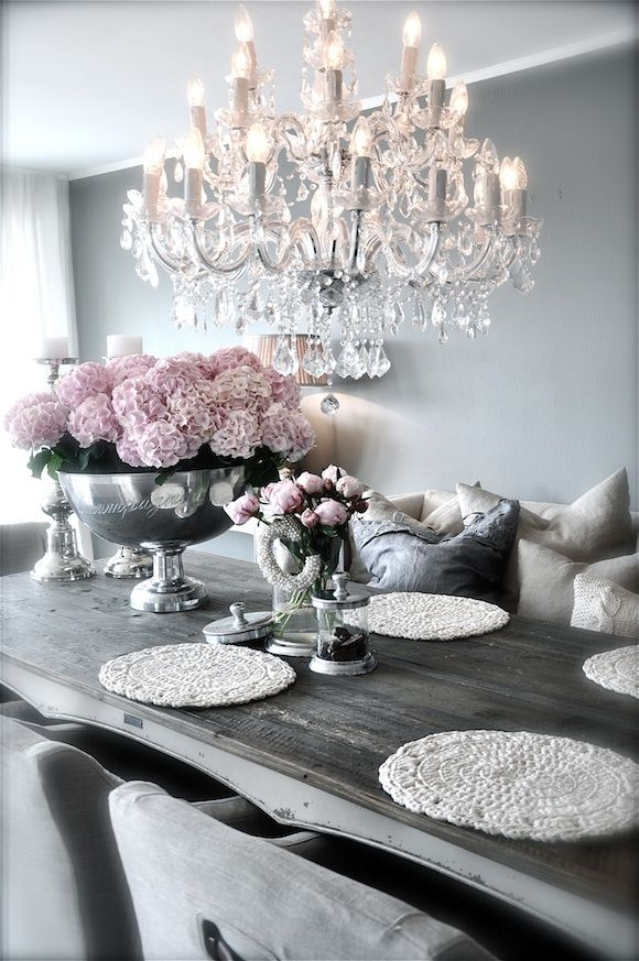 Beautiful dining room in a grey palette with pink and white accents.