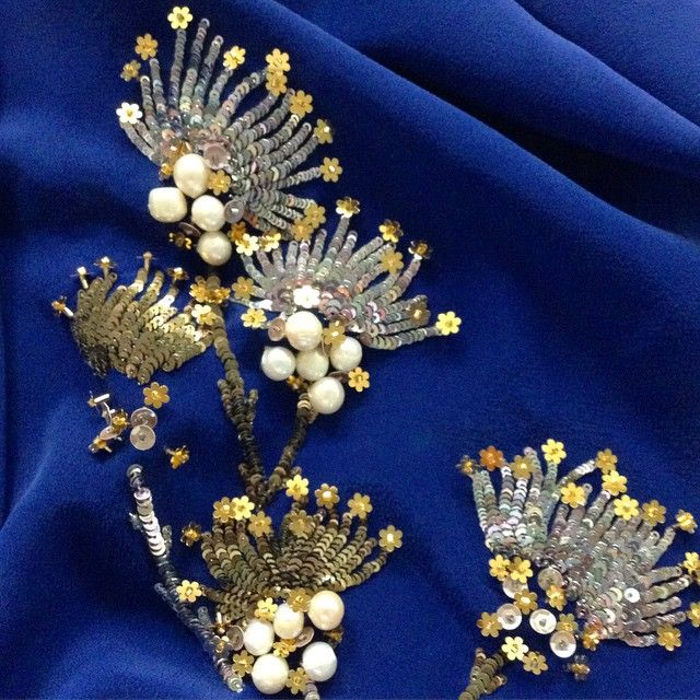Dandelions in silver and gold French sequins set on the deepest blue. #MuseLuxeBeauty