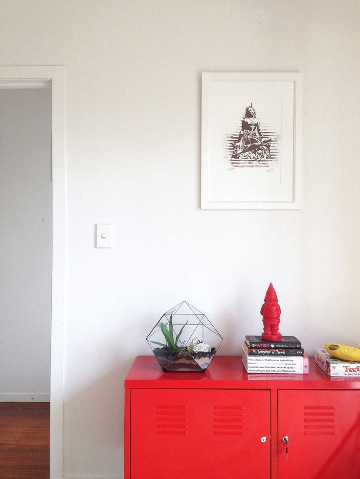 #red Ikea PS unit #Terrarium #bananagrams #red santa candle. #pania print @endemicworld. Staging by Places and Graces.