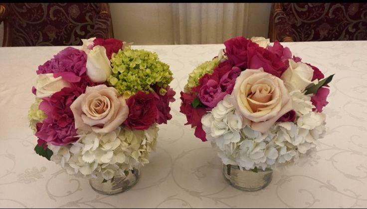 Fresh floral centrepieces .