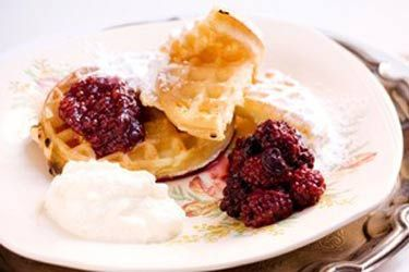 Waffles with raspberry jam, blackberries and ricotta