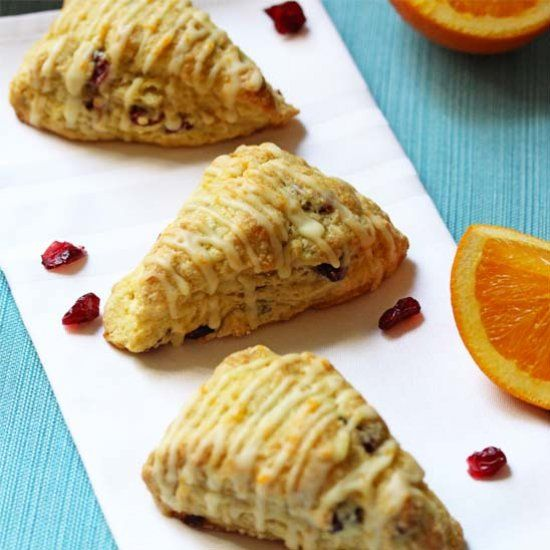 Scones with an orange zest filled with tart cranberries and topped with an orange glaze.
