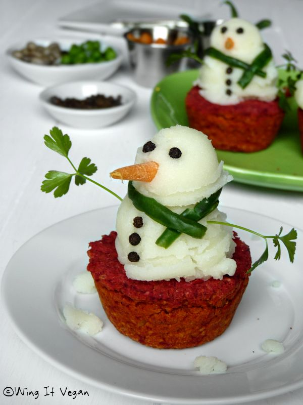 lol...Mashed Potato Snowmen - served on meatloaf made in cupcake pan