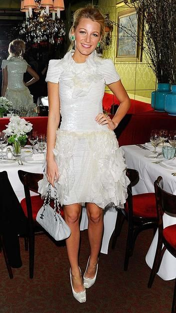 Blake Lively in a Chanel cocktail frock, Christian Louboutin heels, and emerald earrings by Lorraine Schwartz.