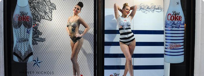 A Live Window Display at Harvey Nichols where live mannequins were body painted into Jean Paul Gaultier Diet Coke bottles.