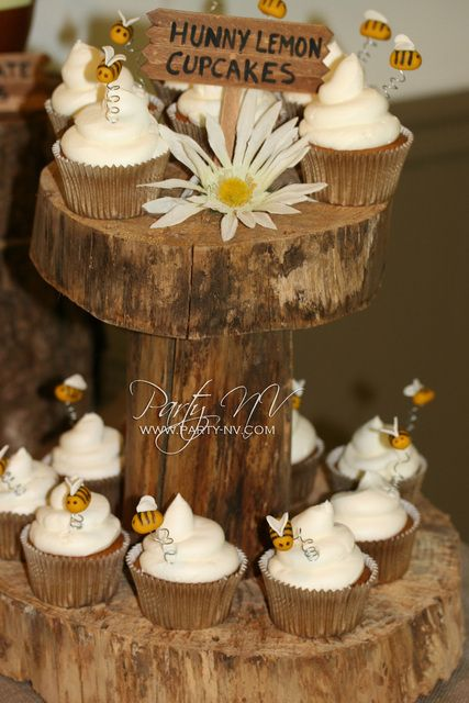 Cute Bee Cupcakes at a Winnie the Pooh Baby Shower #winniethepooh #babyshower  Wonder if I can borrow Gigi's recipe and the McCarthy's wooden cupcake stand from wedding....