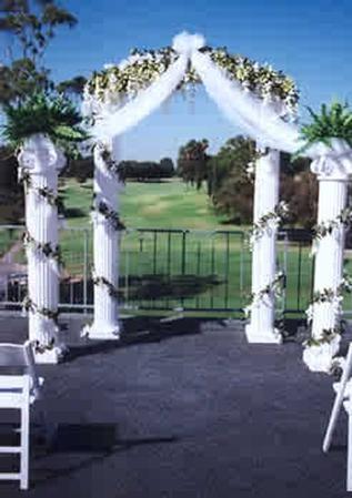 Each Column Is Surrounded With Pre Lit Designer Wedding Decoration Fl Garlands White