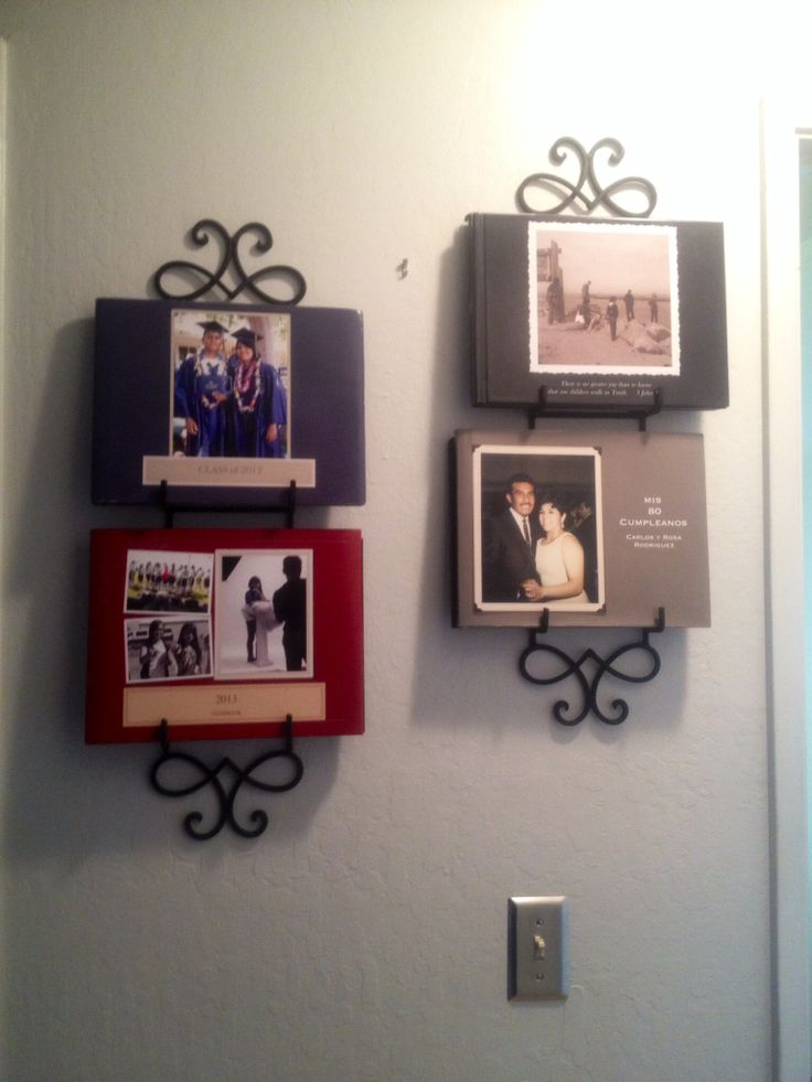 Photo Album Display - Wrought iron plate racks ($6 each at Michael's with coupon)